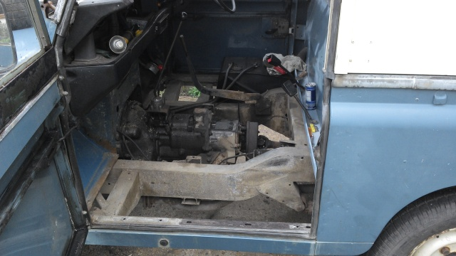 The floor and seatbox out, very greasy transmission