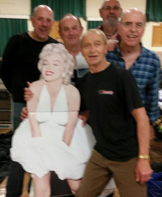 With Mick and Kenny, promoters and some famous woman...